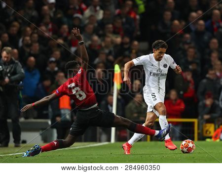 MANCHESTER, ENGLAND - FEBRUARY 12 2019: Paul Pogba of Manchester United  and Marquinhos of PSG during the Champions League match between Manchester United and Paris Saint-Germain at Old Trafford
