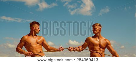 Fit And Full Of Strength. Strong Men Pull Rope With Muscular Hand Strength. Twins Competitors With M