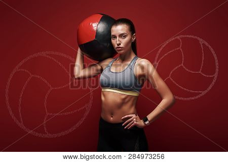 Create Healthy Habits, Not Restrictions. Sportswoman Holds Exercise Ball Standing Over Red Backgroun