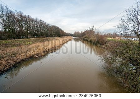 View Over The Dutch River Donge At The End Of A Winter Day. The Photo Was Taken Near The City Of Oos