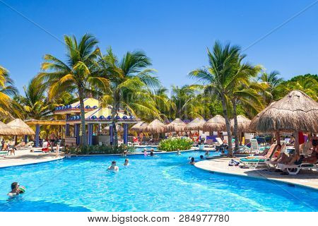 Playa Del Carmen, Mexico - July 20, 2011: Scenery of luxury swimming pool at RIU Yucatan Hotel in Playa del Carmen, Mexico. RIU Hotels & Resorts has more than 100 hotels in 19 countries
