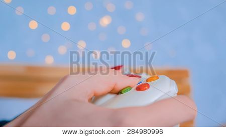 Close Up Shot Of Woman Gamer Hand Playing Video Games With Joystick Or Gamepad At Home. Gaming, Hobb