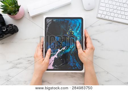 Zagreb, Croatia - February 18, 2019: Women Hands Holding A Box Of Apple Ipad Pro 11 Inch Surrounded