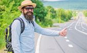 Picking up hitchhikers. Stop car. Man try stop car thumb up. Hitchhiking one of cheapest ways traveling. Hitchhikers risk being picked up by someone who is unsafe driver or personally dangerous poster