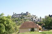 Medieval walls and towers at the top of a hill Turenne France poster