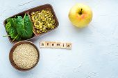 Spinach, pumpkin seeds, sesame, apple on a white background. Anemia concept. Close-up poster
