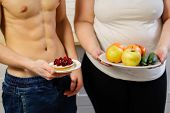 nutrition value, daily calorie limit, weight loss, diet. fit muscle man with sugary cake and overweight woman with healthy good fresh fruit and vegetables plate poster