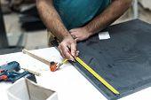 Design wood concept. Cropped photo of cabinetmaker handyman tradesman work with mdf medium density fiberboard make furniture poster