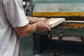 Manual wood small business concept. Cropped photo of cabinetmaker handcraft tradesman using woodworking machine stand in garage or workroom make furniture poster