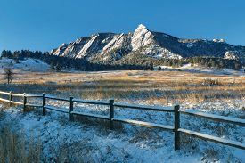 Chautauqua Park in winter with the snow-covered flatirons on Green Mountain just after sunrise in Boulder, Colorado.
