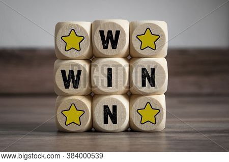Cubes And Dice With 4 Stars And Win-win-situation On Wooden Background
