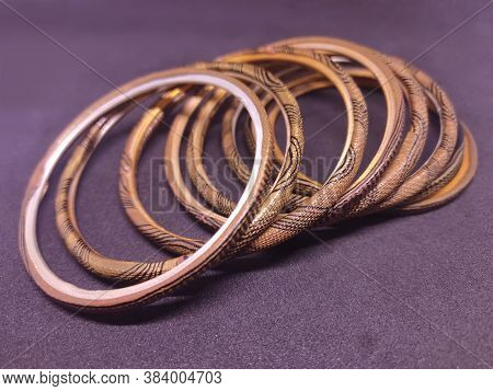 Multicolored Bangles On Black Background. Bangles Are Traditionally Rigid Bracelets, Originating Fro