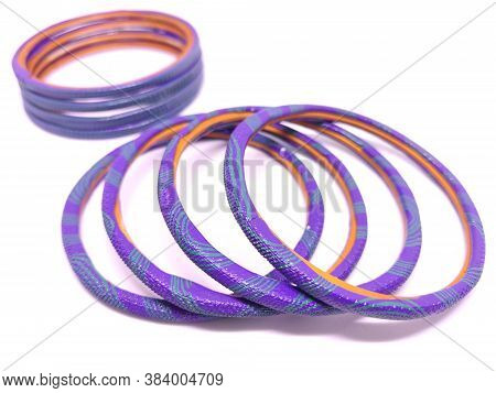 Multicolored Bangles Isolated On White Background. Selective Focus. Bangles Are Traditionally Rigid