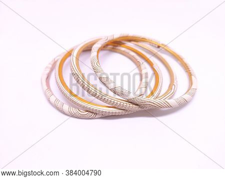 Three Multicolored Bangles Isolated On White Background. Bangles Are Traditionally Rigid Bracelets,