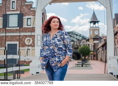 Portrait Of Attractive Plus Size Mature Woman In Casual Style Walk At City At Good Sunny Autumn Day