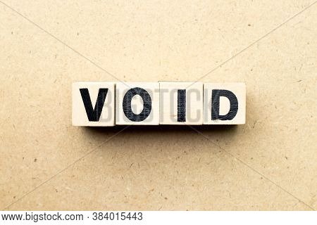 Letter Block In Word Void On Wood Background