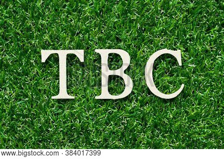 Wood Alphabet Letter In Word Tbc (abbreviation Of To Be Confirmed Or Continued) On Green Grass Backg