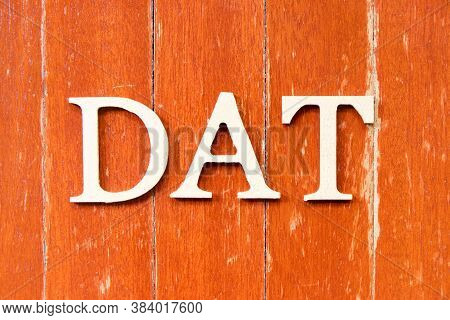 Alphabet Letter In Word Dat (abbreviation Of Delivery At Terminal) On Old Red Color Wood Plate Backg