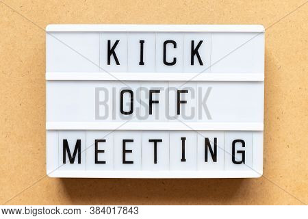 Lightbox With Word Kick Off On Wood Background