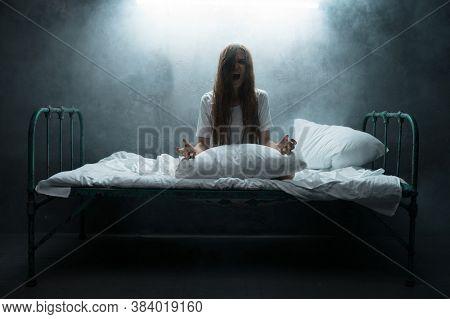 Psycho woman screams in bed, insomnia horror