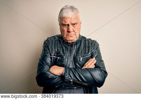 Senior handsome hoary man wearing casual shirt and jacket over isolated white background skeptic and nervous, disapproving expression on face with crossed arms. Negative person.