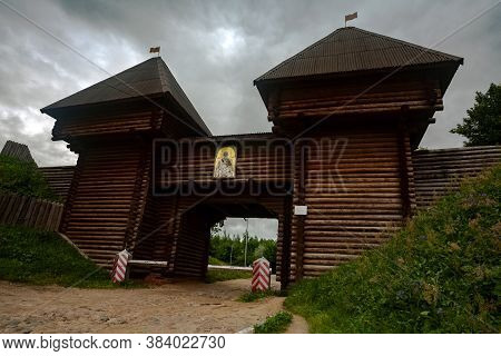Nikolsky Gate Of Dmitrov Kremlin. Wooden Entrance Between Earthen Ramparts