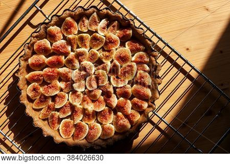 Home Made Figs Pie Un The Sunlight On The Table. Healthy Eating Sweet Organic Food Concept. Selectiv