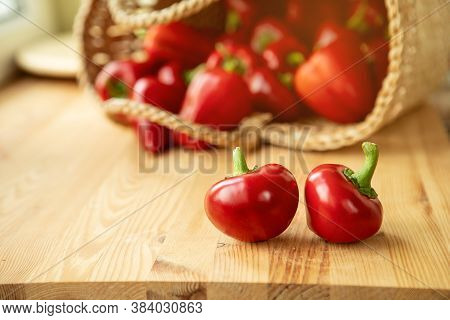 Red Peppers In The Basket. Raw Red Organic Bell Peppers. Ripe Bell Peppers Closeup. Picture With Spa