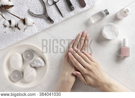 Set Of Manicure Tools And Well-groomed Female Hands With Natural Manicure. Manicure At Home. White C