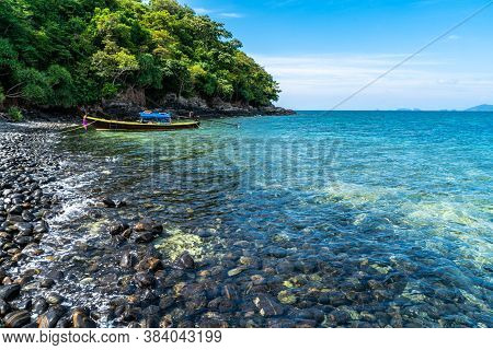 Beautiful Rock Beach With Tourist Long Tail Boat In Koh Hin Ngam, Tarutao National Park, Thailand.
