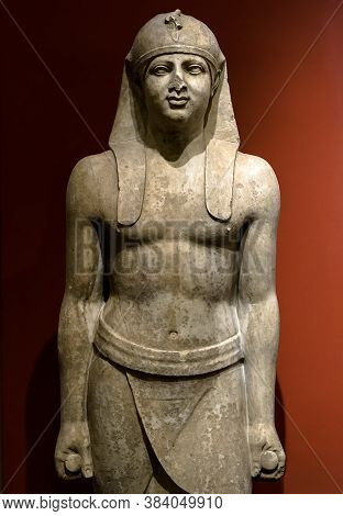 Egyptian Statue Of Pharaoh Or High Official Man, Historical Stone Sculpture. Traditional Art Of Egyp