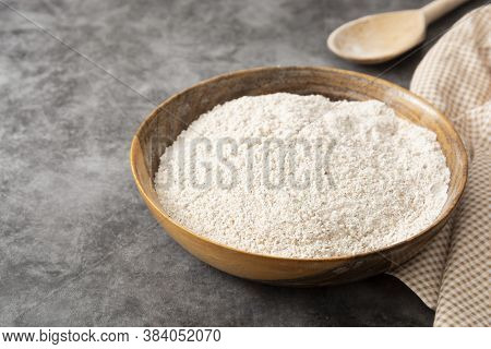 Whole Grain Flour In Wooden Bowl. Baking Ingredient For Pastry, Bread