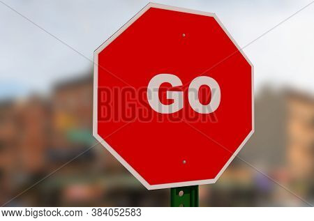 A Red Stop Sign With The Word Go