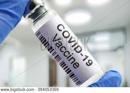 Covid-19 Coronavirus Vaccine In Laboratory, Medication Bottle For Sars-cov-2 Corona Virus Cure. Coro