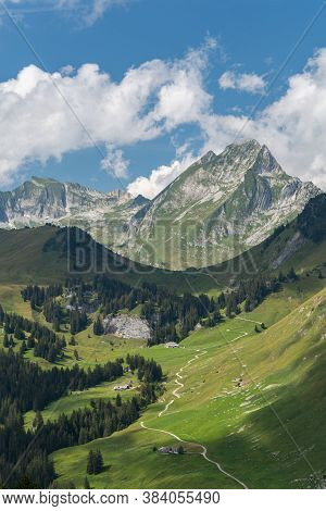 View From Chalet Du Soldat On Dent De Brenleire With Different Chalets, Alpine Willows, Forests And