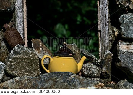 Antique Teapot Beside Old Stone Wall And Window Frame As A Sign Of Irish Hospitality, County Wicklow