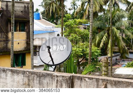 Dish Tv Antenna Or Dish Television Antenna Installation In Roof. Dish Tv Antenna On Roof Of A House,
