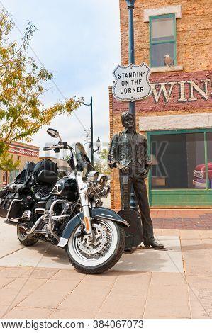 Winslow Arizona Usa - September 22 2015; Black Motorcycle At Famous  Winslow Arizona Br Statue Of Ea