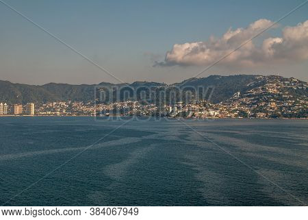 Acapulco, Mexico - November 25, 2008: The Blue Water Bay With On East Side Green Hills Loaded With H