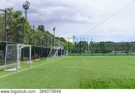 Football Goals Are On Pitch For Soccer Training. Green Sod Covering. Copy Space