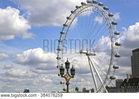 London, Great Britain -may 22, 2016: Ferris Wheel London Eye Against The Blue Sky From Westminster B