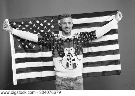 Freedom Forever. Handsome Man Celebrate Winter Holidays Red Background. Guy Wear Winter Sweater. Mer