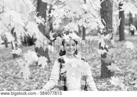Melody Of Autumn. Falling Leaves. Happy Little Girl Wear Headphones On Autumn Landscape. Cute Child