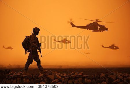 Military Troops And Helicopter On The Way To The Battlefield In The Desert.