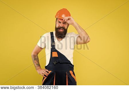 Mature And Experienced Builder In Hard Hat. Expert In Renovation. Brutal Male Worker. Keep Head Safe