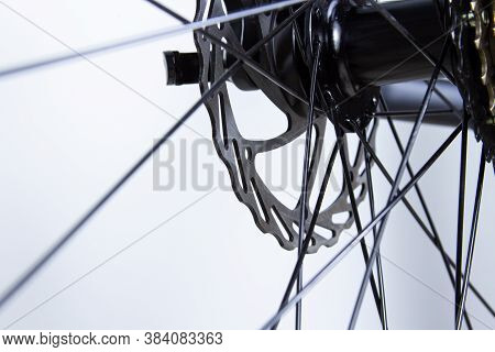 Bicycle Disc Brakes And Spokes. Close-up On Light Background.