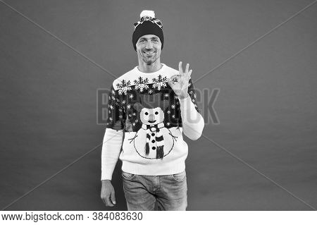 For Seasonal Comfort. Happy Man Give Ok Sign In Fashion Snowman Jumper. Cold Weather Male Style And