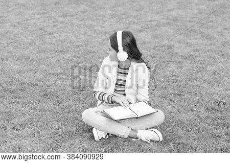 Educational Podcast. Make It Happen. Listen Music Outdoors. Kid Girl Enjoy Music Sit Meadow. Pleasan