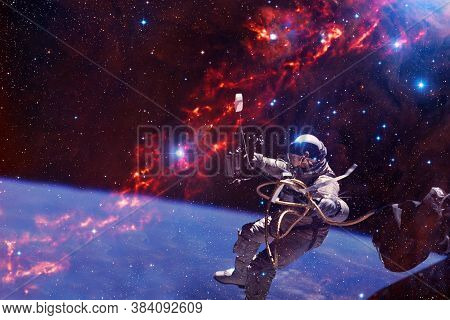 Astronaut. Nebula, Cluster Of Stars In Deep Space. Science Fiction Art. Elements Of This Image Furni