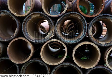 Concrete Sewer Pipes Stacked In Rows On The Street.